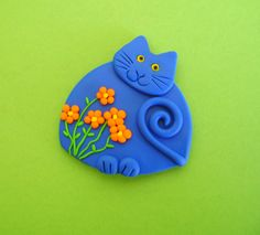 Fimo Polymer Clay Turquoise Blue Cat with flowers Brooch Pin or Magnet.