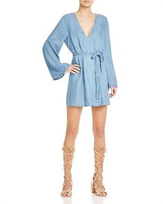 Wear this bell sleeve chambray wrap dress all summer long. Change up your accessories depending on the occasion.