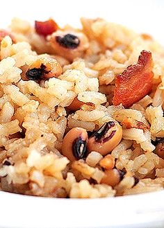 Hoppin' John Recipe is the perfect recipe for New Year's Day. It's a traditional dish that's easy to make.   shewearsmanyhats.com