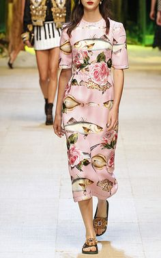 Rendered in silk, this **Dolce & Gabbana** dress features a placed trout print with an embroidered rose applique and a sheath styled silhouette with a midi length hemline.