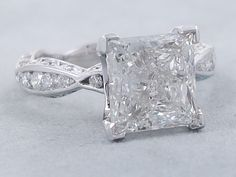 This is our fabulous 3.65 ctw Princess Cut Diamond Engagement Ring that has a 3.05 ct Princess Cut F Color/SI1 Clarity, Clarity Enhanced Center Diamond and it's just on fire. It is set with accent diamonds everywhere you can see with an infinity style band…It sparkles in 14K white gold and listed for $17,990 Diamond Rings, Diamond Engagement Rings, Princess Cut Diamonds, Treasure Chest, Diamond Shapes, Bling Bling, Beautiful Rings, Sparkles, Clarity