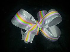 Silver glitter bow with a splash of color! Sold on beccas little designs on facebook! $4