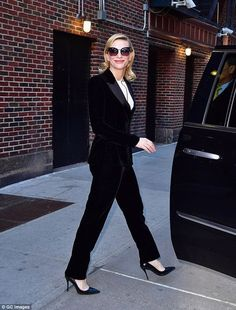 Stunning! The two-time Oscar winner showcased her svelte figure in the two-piece velvet suit with a white blouse underneath, and elongated her statuesque frame by sporting a pair of black heels