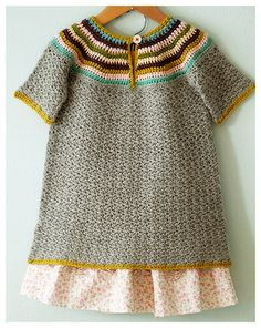 I love the colors & collar- inspiration for a crochet project!