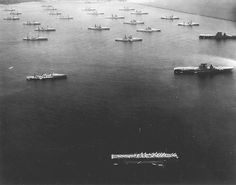 All three of the United States Navys aircraft carriers at the time Langley Saratoga and Lexington along with battleships and cruisers at anchor in Colon Panama Canal Zone after Fleet Problem X 1 March 1930.