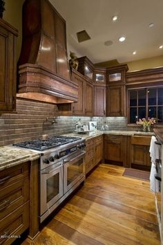 Country Kitchen with Flat panel cabinets, Complex granite counters, Stone Tile, Copper Range Hood '0272', Custom hood