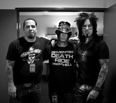 I tried to focus my Leica for my friend to snap this picture but rangfinders are their own animal..a slightly outta focus yet happy to hang out gang of pirates.:) Cory Miller,DJ Ashba and me..Sydney Australia  Leica M9,35mm lenses. Copyright Nikki Sixx