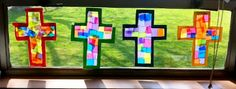 """Stained Glass"" cross window decorations made with Contact paper and tissue paper squares"