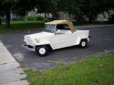 1967 King Midget.  These things are one of the smallest cars ever made.  They had 8 inch tires and a one hp motor!