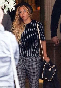 Hot mama! The 32-year-old was stylish as ever in navy blue and white checked pants, a matching vertical striped short-sleeve blouse and pale green stilettos, with a black bowler hat topping her long golden tresses