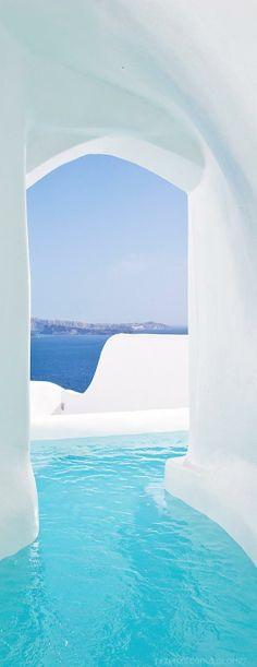 Take a dip in one of the pools of the hotels of Oia, a whitewashed town in Santorini, Greece.