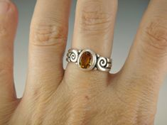R916- Sterling Silver Ring with a 8 x 6 Faceted Oval Golden Citrine. Size 8+. I can size it to fit, just contact me. No charge to size down, and no charge for one size up. The top of the ring measures 10 mm and the band is 4 mm. This ring is made by the Lost wax Casting method,