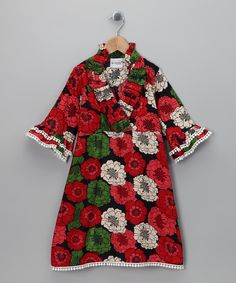 Classic, heirloom-quality style mingles with an Indian-inspired print in this darling dress. Thanks to a slight wrap silhouette, layers of bitty pom pom trim and exclusive, high-end construction, this cotton wonder shines as a floral treasure.100% cottonMachine wash; tumble dryMade in India
