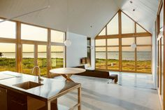 Inside a pitch-roofed beach house in Canada