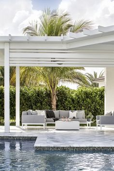 Custom designed pergola by pool, with beams add some extra charm to this luxurious outdoor space White Pergola #backyard #pergola #whitepergola #pool #luxurioushomes #Florida