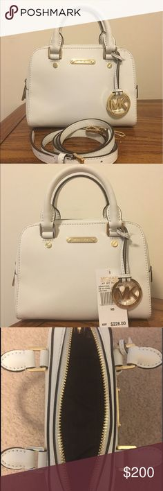 """NWT Michael Kors Small White Leather Satchel NWT Michael Kors Stunning Optic White Jet Set Small Leather Satchel!! Just in time for spring!! Measures approximately 8"""" in length & 6.5"""" in height-this bag also includes an adjustable strap if you want to use the bag as a crossbody !!!! The price tag fell off the bag, so it isn't attached to the bag, but it's included in your purchase 😊 FIRM price Michael Kors Bags"""