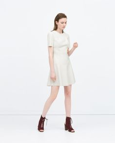 Image 1 of FAUX LEATHER DRESS WITH LAYERED SKIRT from Zara