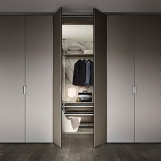 Cover freestanding with upper filler and structure in piombo lacquered aluminium, hinged doors in grigio ombra mat lacquered glass, side and back panels in grey transparent glass. Closet Doors, Walk In Closet, Luxury Interior Design, Interior Architecture, Dressing Room Closet, Tempered Glass Door, Drawer Unit, Wardrobe Design, Sliding Doors