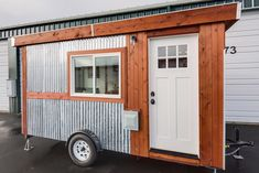 """Graham Berry, who built """"Walden"""", his micro-house of 98 sq ft, fit everything in without a loft. He managed to squeeze in a day bed, a decent bathroom with shower, and kitchen all within a 7′ x 14′ area.   Tiny Homes"""