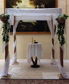 Cedar with ornamented satin and sheer organza drapes www.chuppah.ca at the Windsor Arms Hotel