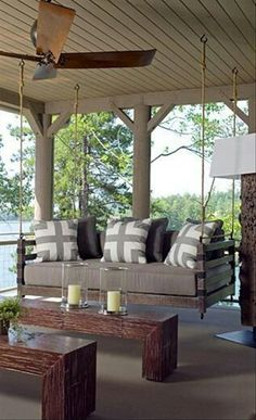 We all love sofas, so why not hang one up and make a swinging sofa? This style has both comfort and class, acting as both decorating and furniture! Choose pillows and a sofa color that go great with the rest of your porch decorations.