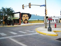60' x 18' Painted Mural - My first mural this is the one that started it all. After this one I was hooked on painting large walls. This mural is located downtown Gillette Wyoming the town I grew up in.