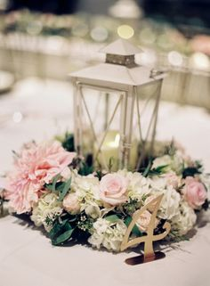 Classic pink floral + lantern centerpiece: http://www.stylemepretty.com/maryland-weddings/solomons/2016/03/04/classic-garden-inspired-solomons-island-wedding/ | Photography: Vicki Grafton - http://www.vickigraftonphotography.com/