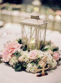 Classic pink floral + lantern centerpiece: http://www.stylemepretty.com/maryland-weddings/solomons/2016/03/04/classic-garden-inspired-solomons-island-wedding/ | Photography: Vicki Grafton - http://www.vickigraftonphotography.com/