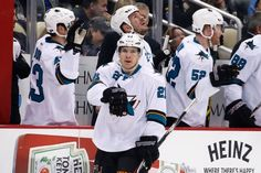 San Jose Sharks forward Ben Smith celebrates with the Sharks bench after scoring a goal (March 29, 2015).