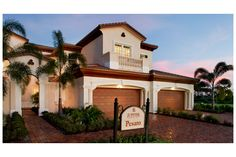 A graceful arched entry and courtyard lead to the Pesaro model from Toll Brothers. New Carriage Homes in Jupiter Country Club. Jupiter, FL.