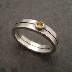 """A square wire engagement ring with a 3mm citrine. Just over 3/16"""" wide (5mm) with a shiny finish."""