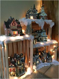 """My 2015 village display! Made using crates Christmas lights and """"snow"""" Love this idea for my Christmas Village. Walmart sells these crates. Noel Christmas, Country Christmas, Christmas Projects, Christmas Lights, Christmas Ideas, Griswold Christmas, Christmas Mantles, Christmas Baskets, Victorian Christmas"""