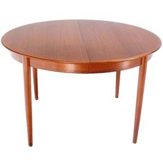 Danish Mid-Century Modern Round Teak Dining Table with Three Leaves | From a unique collection of antique and modern dining room tables at https://www.1stdibs.com/furniture/tables/dining-room-tables/