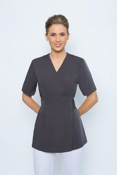 SPA 12 wrap tunic - Charcoal grey. This new tunics is incredibly comfortable with a wrap tie and button fastening. Invisible button at Bust line so it doesn't gape. Short sleeve and long enough to cover your bottom. Available in sizes 6-24, normal fit ( refer to our sizing chart ) Available in black, white, charcoal grey and taupe.