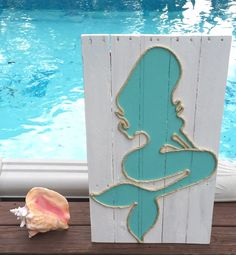 A personal favorite from my Etsy shop https://www.etsy.com/listing/259480471/hamdmade-mermaid-woth-rope-beach-pallet