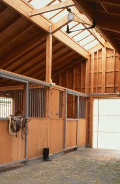 horse stall doors Garage And Shed Traditional with barn barn doors concrete floor Horse barn Horse Stalls