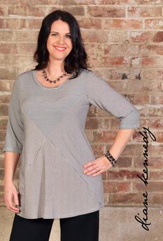 Style ahoy! This sassy #tunic features a lovely narrow nautical striped fabric, so perfect for your summer wardrobe. Afraid of horizontal stripes? This style has the lines pointing in all directions, breaking up your figure in the sleekest way.  Starboard Tee- Black Line  #dianekennedy #plus #regular #plusfashion #fashionover40 #fashionover50