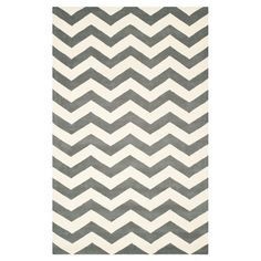 Anchor your living room seating group or define space in the den with this artfully hand-tufted wool rug, featuring a chevron motif for eye-catching appeal.