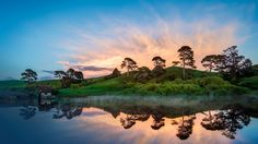 Trey Ratcliff Happy Here's Hobbiton in New Zealand in the morning The only sound you could hear was the little water mill on the left slowly churning through the water as the mist started to gather across the lake. Visit New Zealand, New Zealand Travel, Sunset Wallpaper, Nature Wallpaper, 3840x2160 Wallpaper, Beautiful Wallpaper, Widescreen Wallpaper, Landscape Wallpaper, Computer Wallpaper