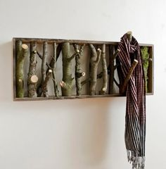 Use downed branches to make a scarf, leash, hat rack