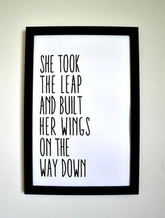 She took the leap and built her wings on the way down.    This inspiring print, featuring black and white typography, will look great in any