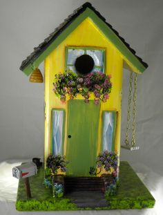 Unique, Gorgeous, Birdhouse Hand Painted Yellow and Green. $99.00, via Etsy.
