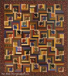 """A new pattern called Waltzing Leaves by Pam Buda of HeartspunQuilts.com  This 70 X 80"""" quilt is a stash buster and easy to piece!  Featured on the cover of American Patchwork & Quilting magazine!!"""