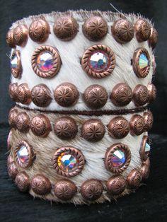 Hair on cowhide bracelets with rim set AB crystals by Running Roan Tack http://www.runningroantack.com/bracelets.html