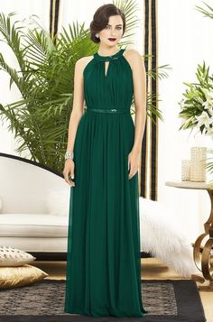 Different neckline. Something sort of unique. Those look like green sparkles on it too. Loving the way they styled the girl too. Sparkly cuff and art deco earrings.   Dessy 2887 Bridesmaid Dress | Weddington Way