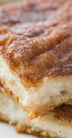 Eating one of these Churro Cheesecake Bars is like biting into a sweet, cinnamon-coated churro, only to find sweet, creamy cheesecake inside.