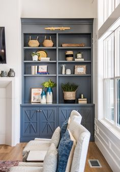 blue built in shelves storage in living room Built In Shelves Living Room, Bookshelves Built In, Living Room Storage, Living Room Decor, Bedroom Decor, Blue Living Room Paint, Bookcases, Bedroom Paint Colors, Interior Paint Colors