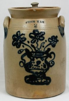 Penn Yan 2 gallon preserve jar with fitted stoneware lid. Beautifully decorated with a flower vase and bouquet. Great blue, triple flowers and dots are featured.  Additional blue accents at the ears