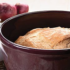 This easy no-knead loaf, featuring whole wheat and flax flours, gains flavor from a long, cool rise.