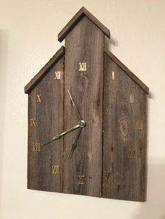 "This wall clock is 17"" tall and is made from reclaimed fence wood."
